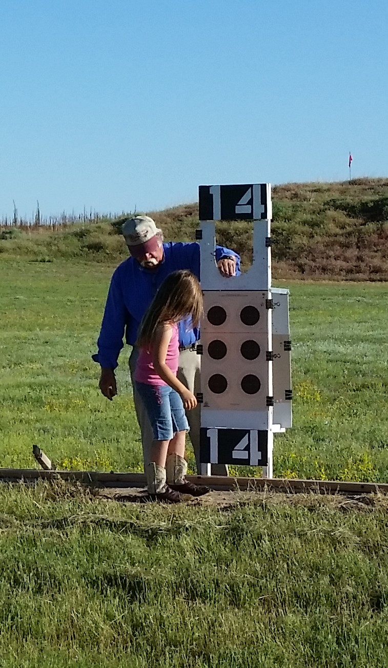 This is Barney and Emma hanging targets.
